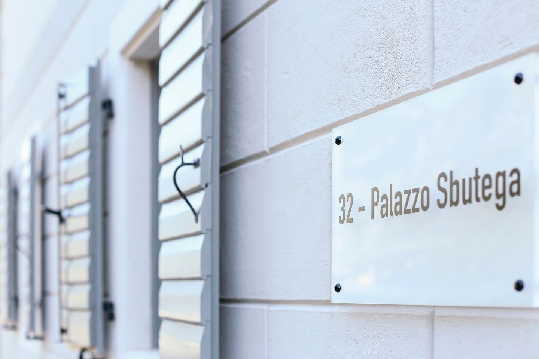 Palazzo Sbutega sign on facade