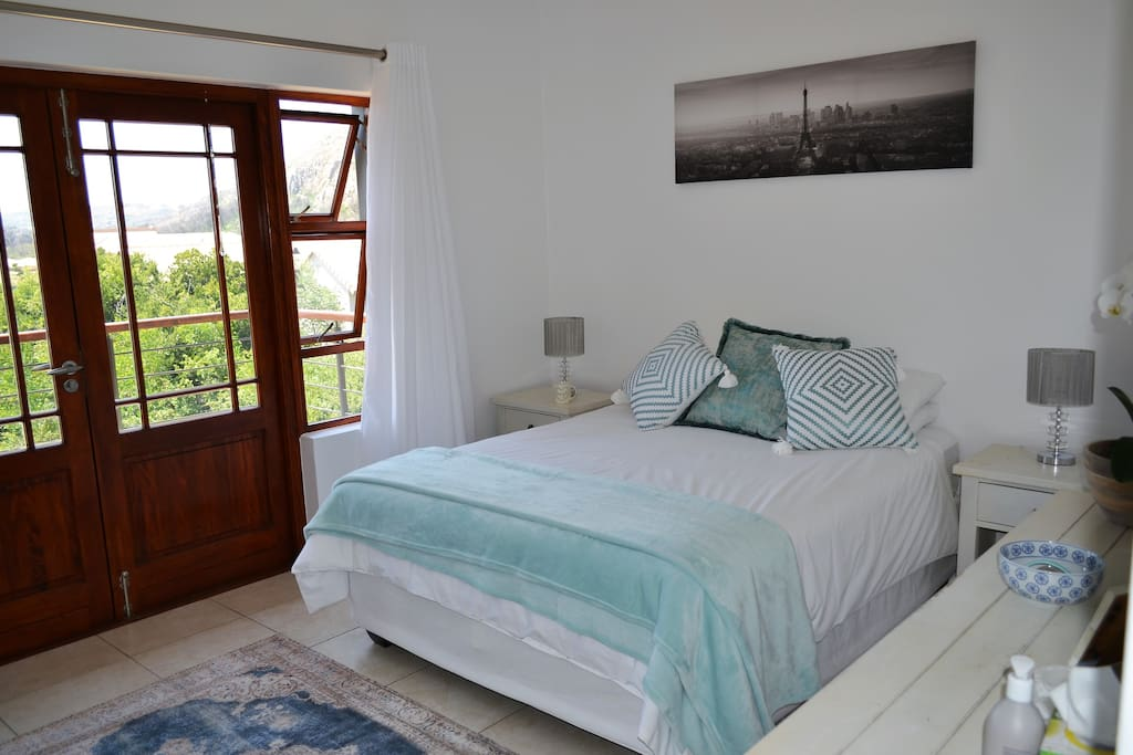 Bedroom with Queen size bed and balcony