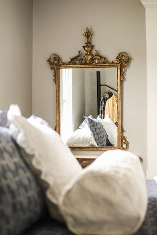 """Master Bedroom with King size bed. Smart TV above the orginal fireplace. The mattress, duvet and exquisite linens is the most memorable luxury you will experience at """"A SOFT PLACE TO FALL"""". Every review confirms my thoughts. Pristine Clean Always!"""