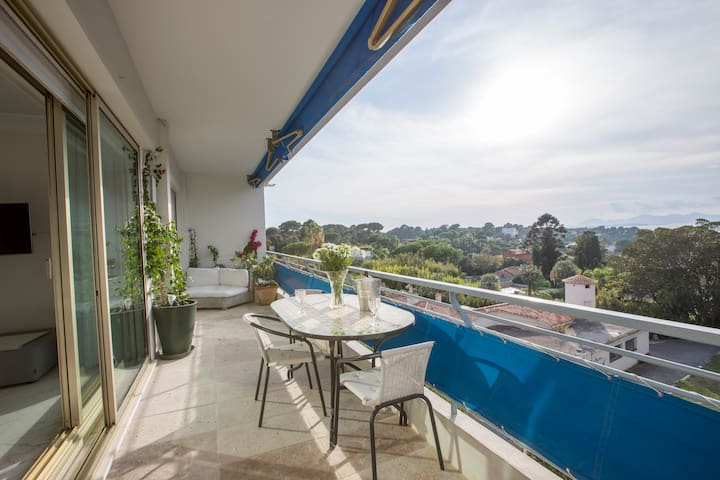 Take in the amazing views from the full length front terrace with ample seating and dining area.