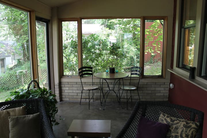 Enjoy coffee, tea or cocktails with good books or good friends in the front sunroom
