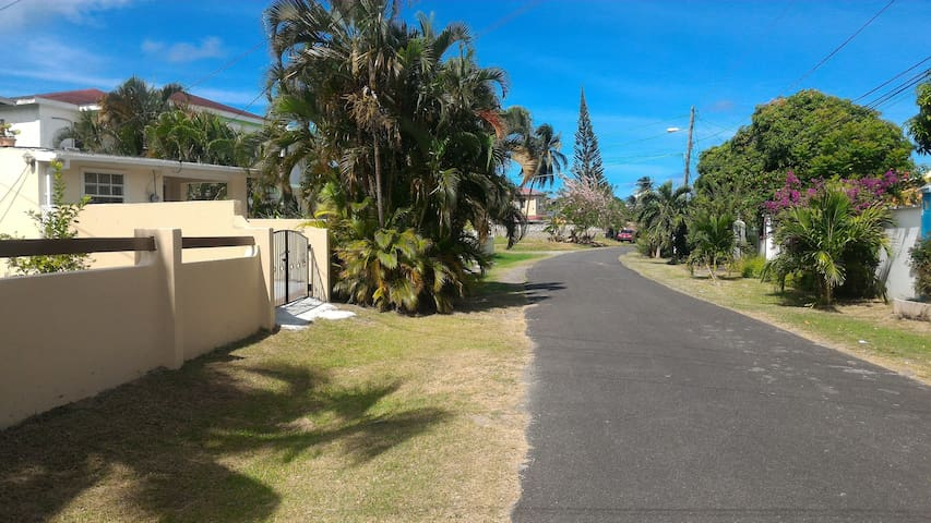 Apartment entrance on the left. Area is great for sunrise walks or to catch a wonderful Caribbean Sunset