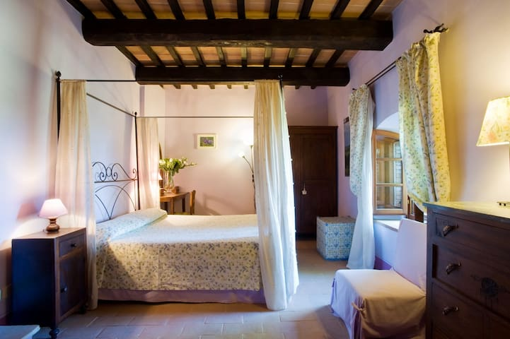 Bedroom 1- Each bedroom at Villa Tramonto has a personality marked by a variety of shapes and color themes. All are air conditioned. Bedroom 1 on the ground floor of the main villa has a queen size bed and en suite bathroom with tub and hand shower.