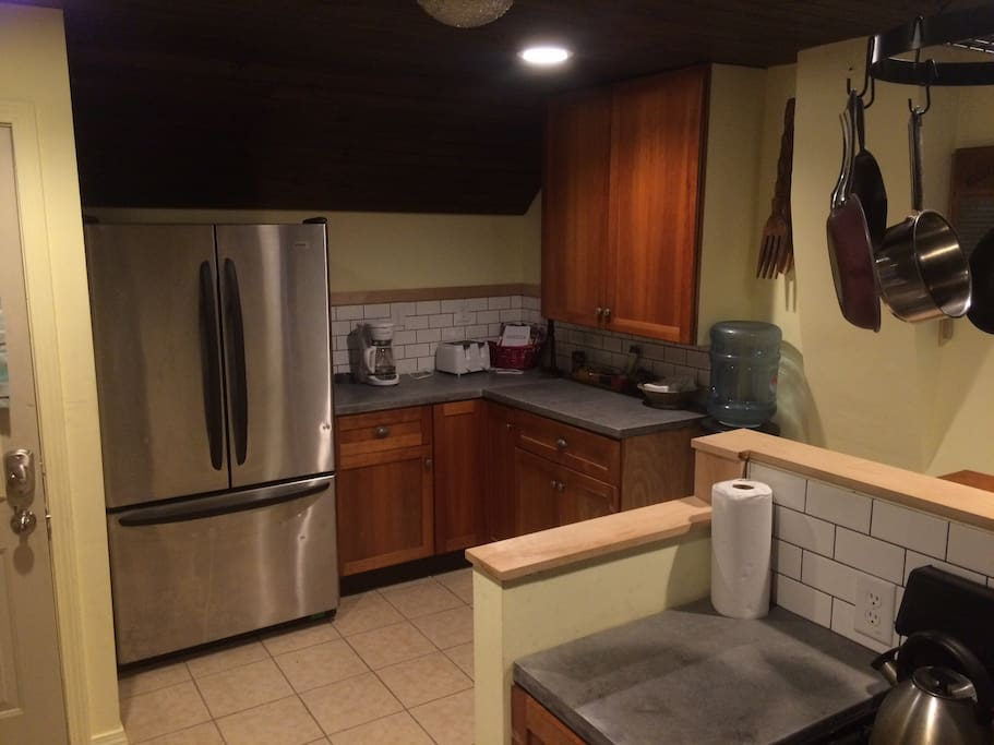 Updated kitchen with Full refrigerator and gas range