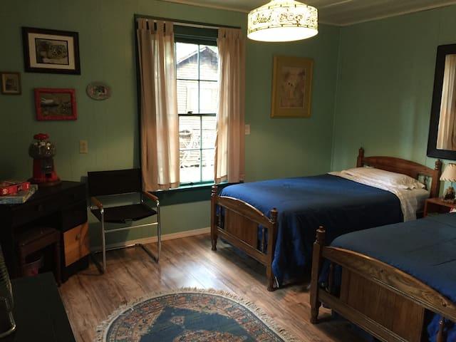 2 twin beds, desk, dresser and closet