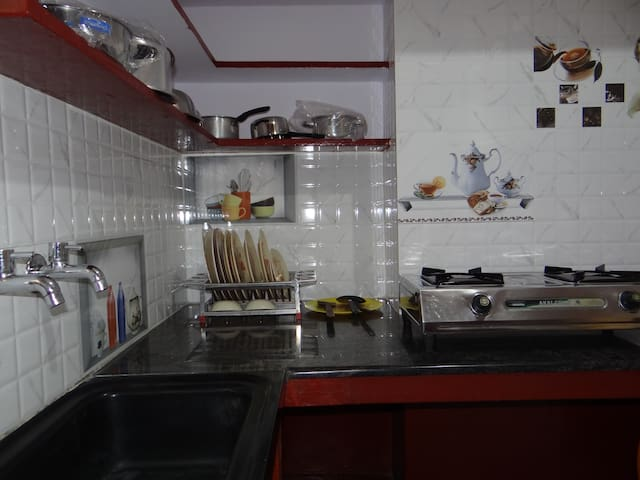 Private kitchen with utensils and gas stove for cooking