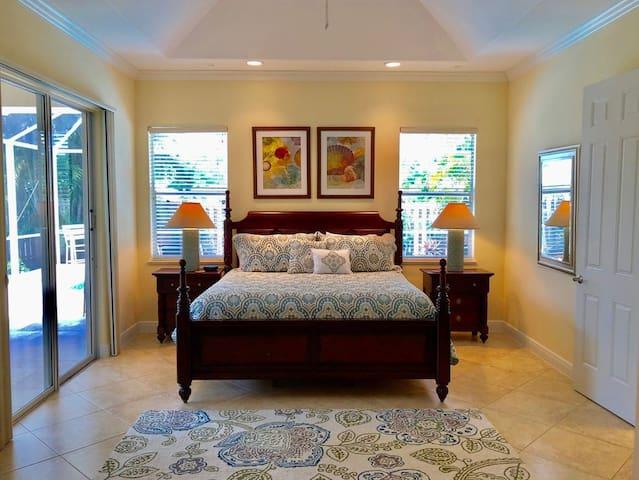Master bedroom King  dresser, desk, Smart TV sliders to pool Vaulted ceilings