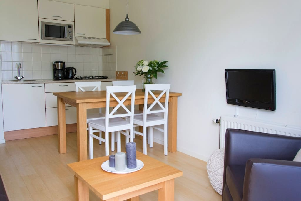 Gezellige woonkamer met kitchenette