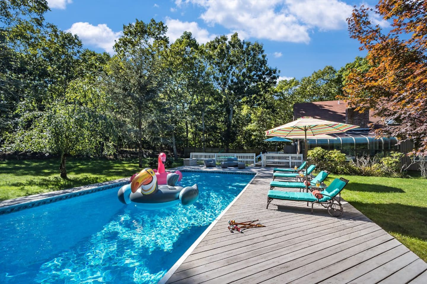1.2 acre East Hampton property centrally located 5 minutes from the village and beach. Modern home features: a 20x40 Sunny pool, a wrap around deck, 3 bedrooms and 2 1/2 bathrooms, a sun room and also a basketball court.