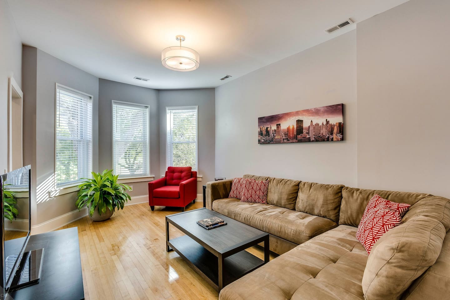 Lounge in your living room with views overlooking the park