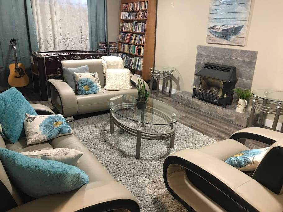 Comfortable living room with foosball, books, games and more