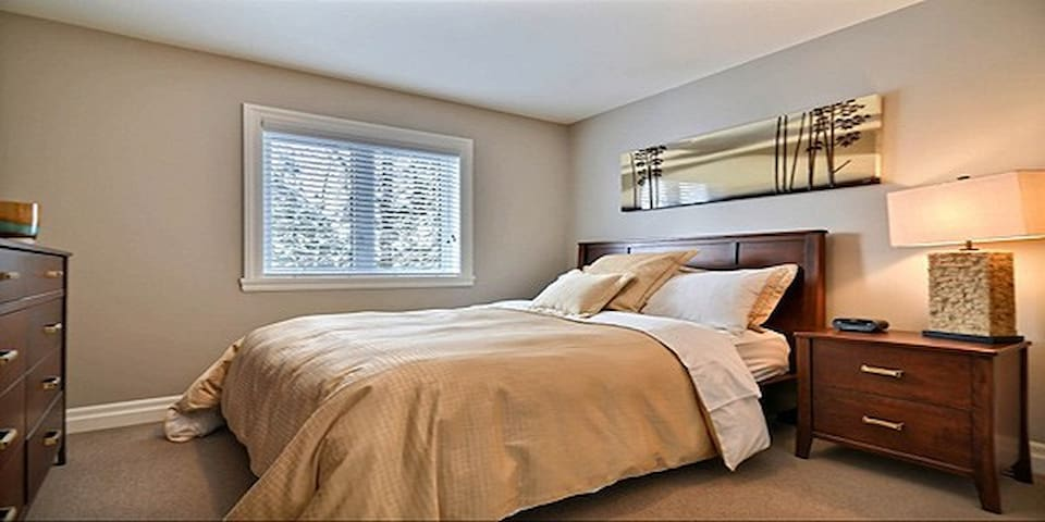 Bedroom number two with a queen size bed.