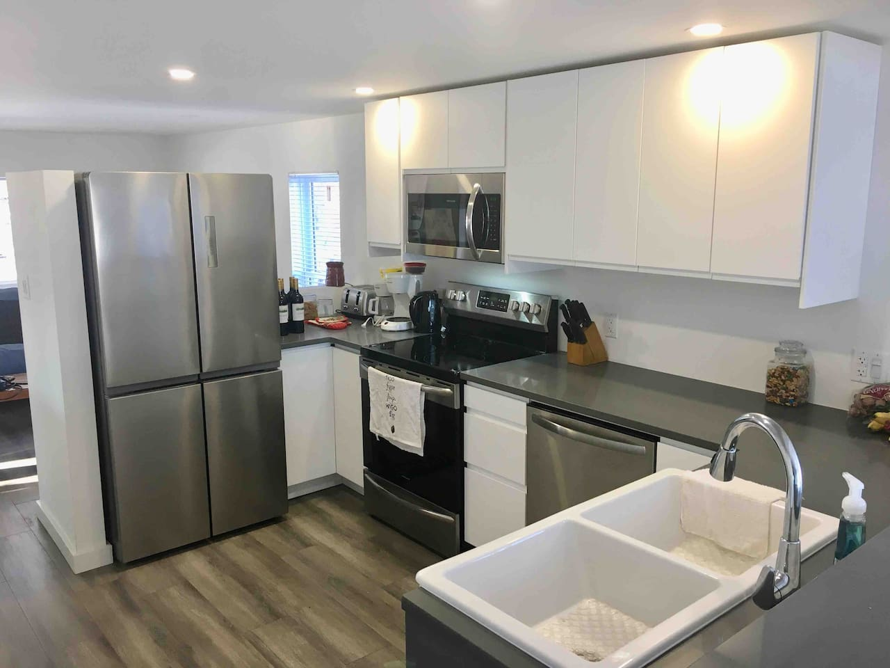 A well stocked kitchen with all new appliances and Quartz countertops