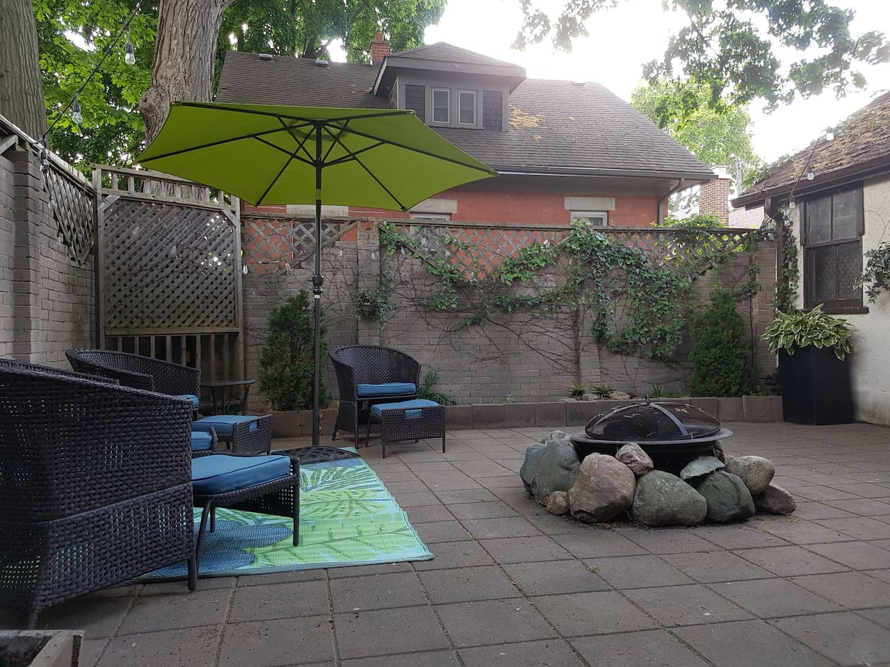 cozy and private backyard to Relax Inn. Remote control Patio Lanterns will light up your little piece of paradise