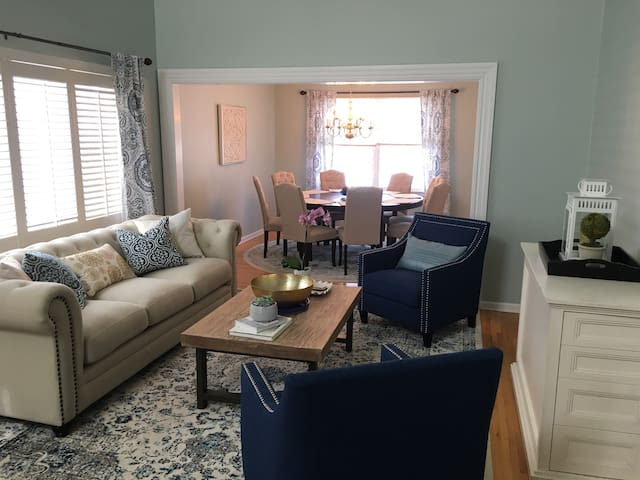 Formal living room and formal dining with seating for 8.