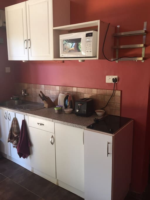 Fully equipped kitchenette with toaster, microwave, water boiling kettle and ceramic hob for cooking