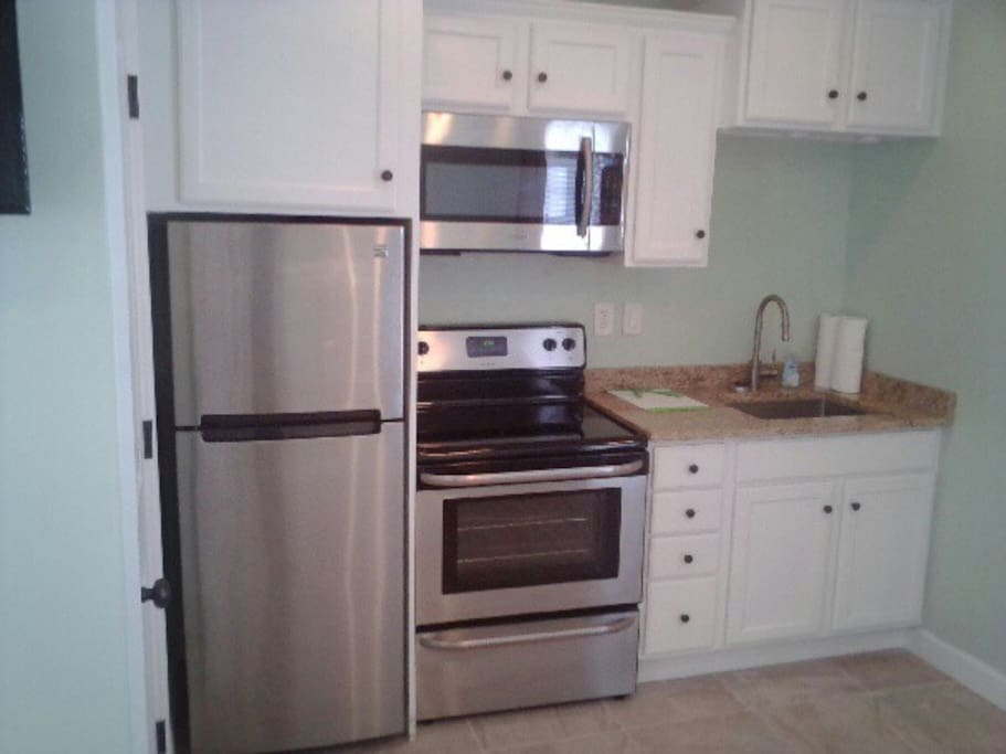 This is a typical kitchen - might not be exact style and it is fully renovated with new tiles and cabinet