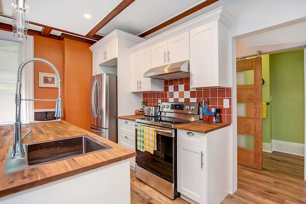 Kitchen is fully equipped and a dishwasher located in the island