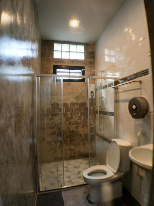 Shared bathroom with rain shower and warm water.