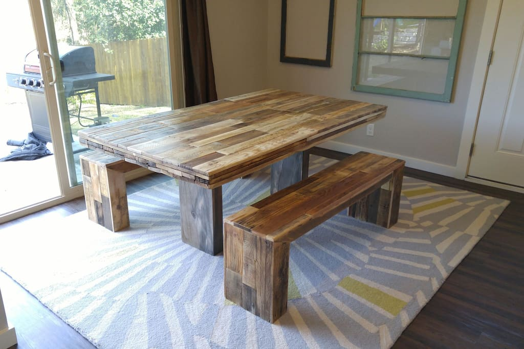 Hand made reclaimed dining table looking onto the patio.