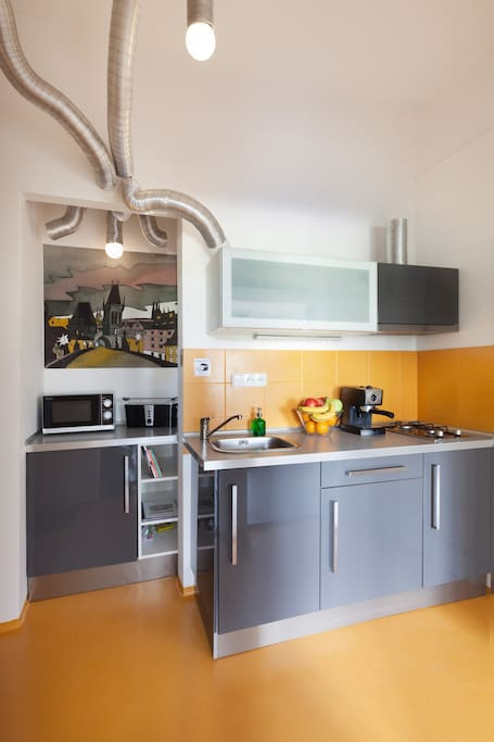 Fully equipped kitchen with espresso maker fridge, freezer, cooktop, microwave, toaster and kettle