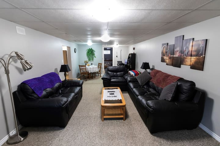 Large living room complete with leather couch, loveseat and chair for your comfort.