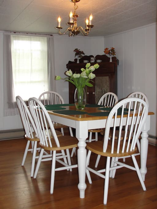 Dining room table seats 6.   A large kitchen farm table can be used to seat others or for serving buffet style.