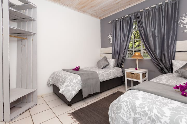 Bedroom 2 furnished with two single beds.