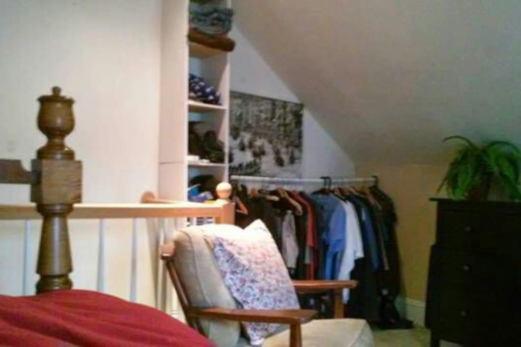 this shows the built-in closet and the small sitting chair