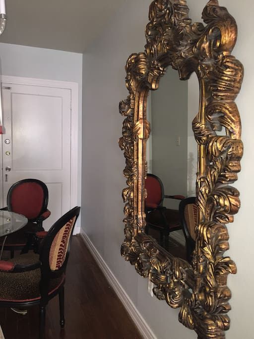 Ornate mirror in dining area