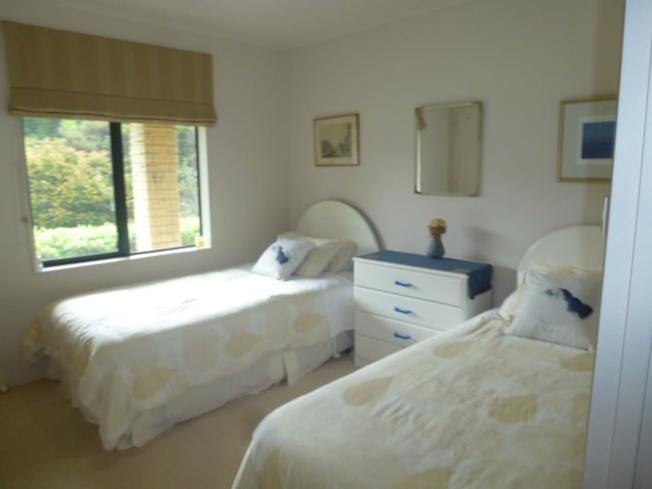 This room is medium sized with one king single and one single bed, tallboy and double wardrobe. It has pretty rural views from the window.