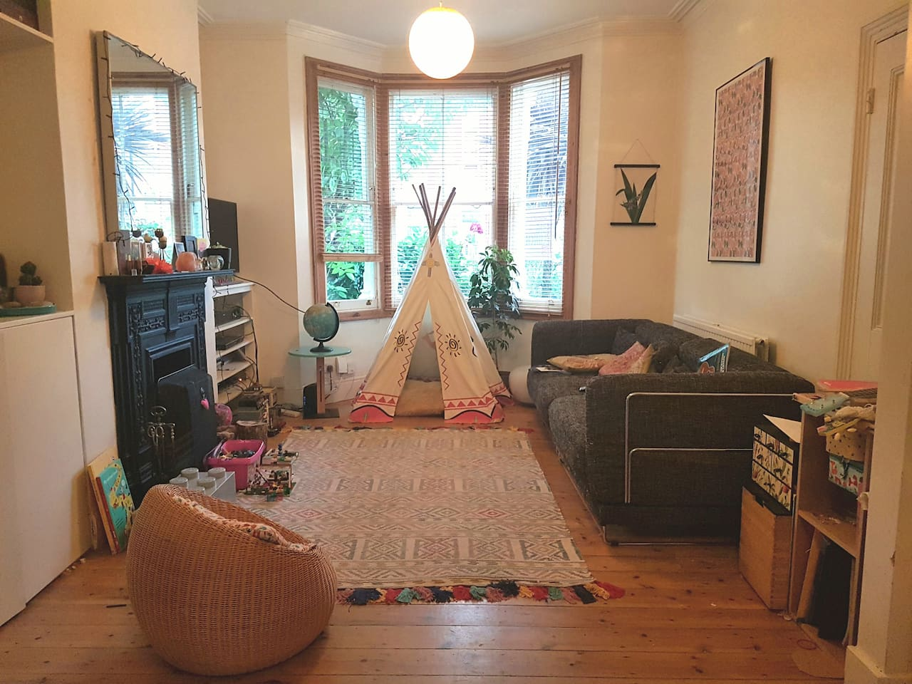 Living room. With teepee for kids (or adults) to hide in!