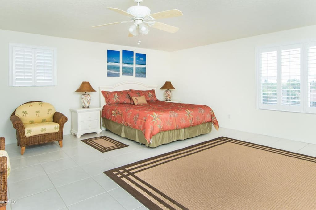 King sized bed on 3rd floor master suite and a balcony with ocean view