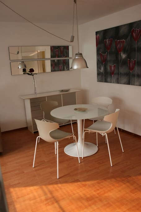 Modern round glass table with 4 chairs - only Italian design furniture