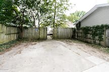 Private, two-space parking behind fence, accessible from rear alley.