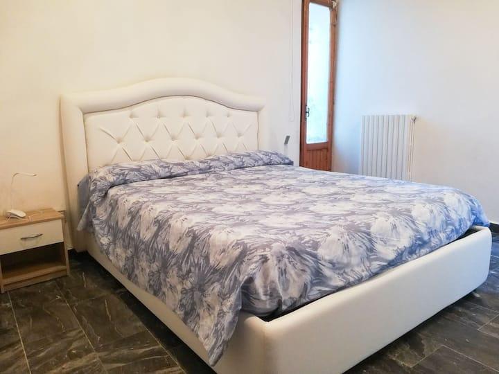 Confortevole camera nella campagna Toscana