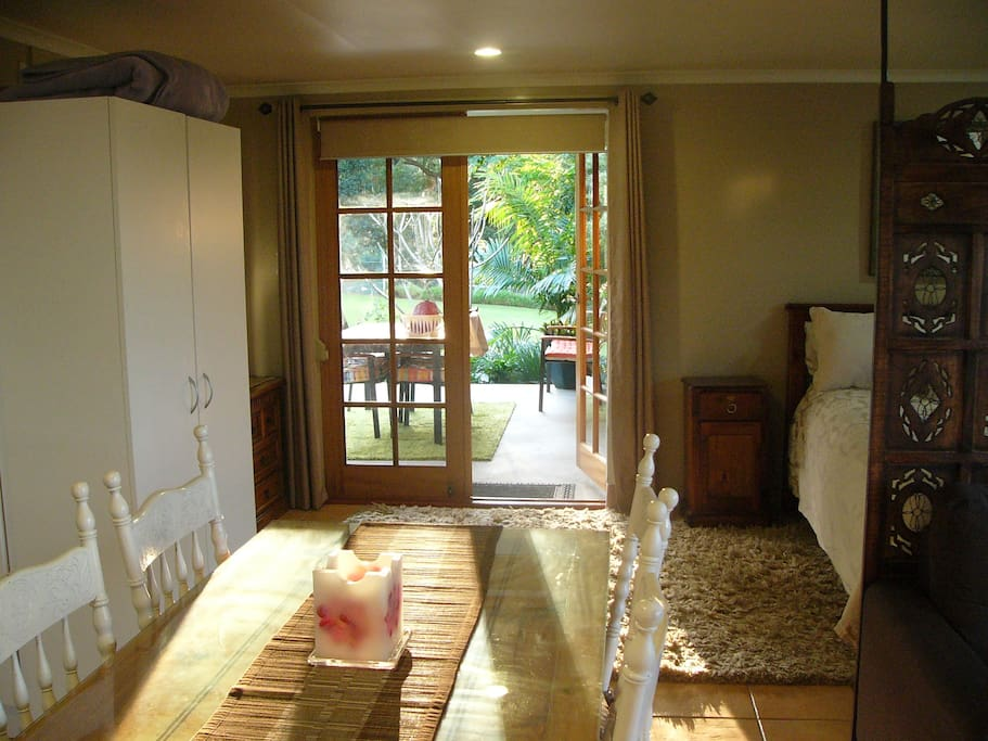 French doors leading onto private deck overlooking gardens