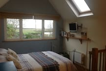 Comfy bed with great views out to the marshes and beach