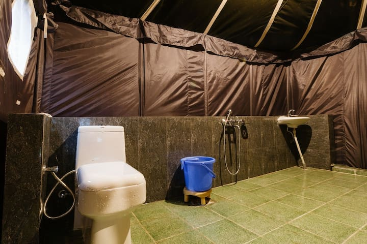 tent has attached western toilet and bath with hot water