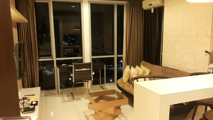 1 bedroom suite with living room at Kemang Mansion