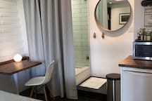 Breakfast or work table, new tile shower, kitchenette for coffee and snacks.