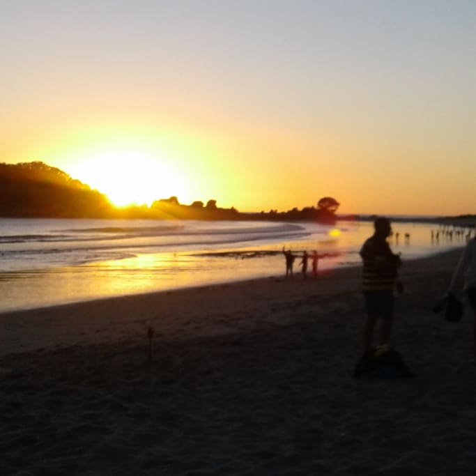 Sunrise on Mt Maunganui beach - start your day with an early morning walk.