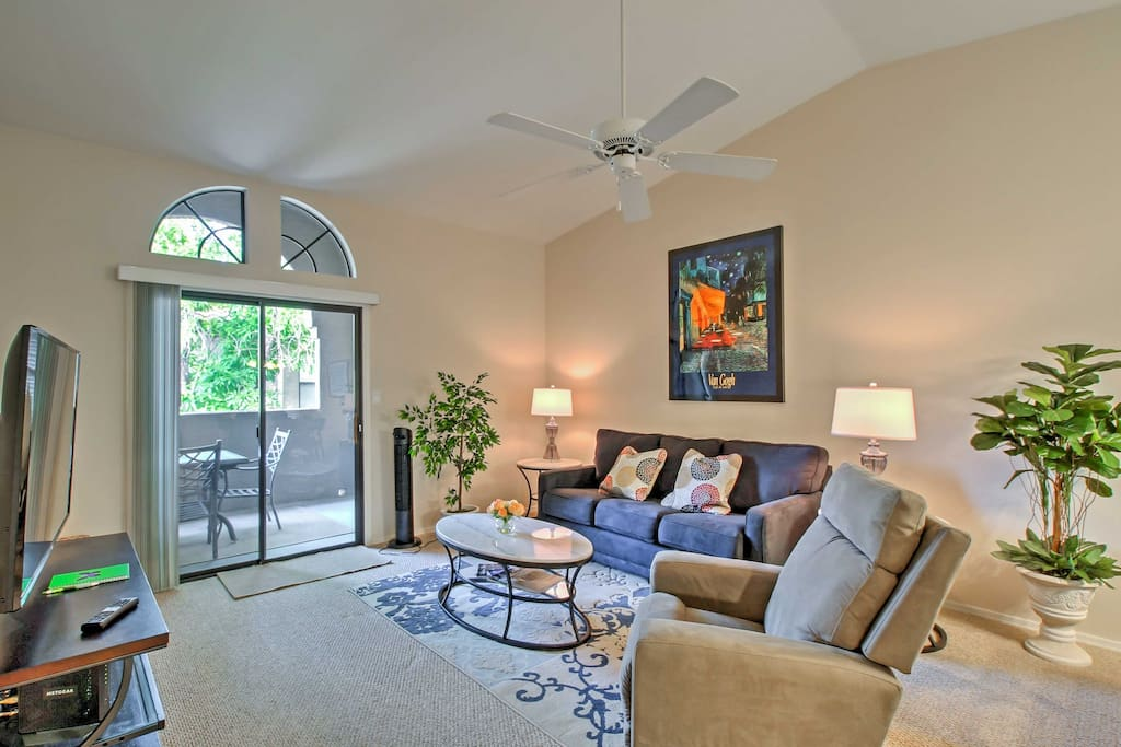 Stylish furnishings fill the interior, including this cozy and welcoming living room.