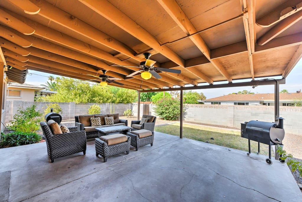 Spend your days relaxing out in the backyard and catching some shade under the covered patio.