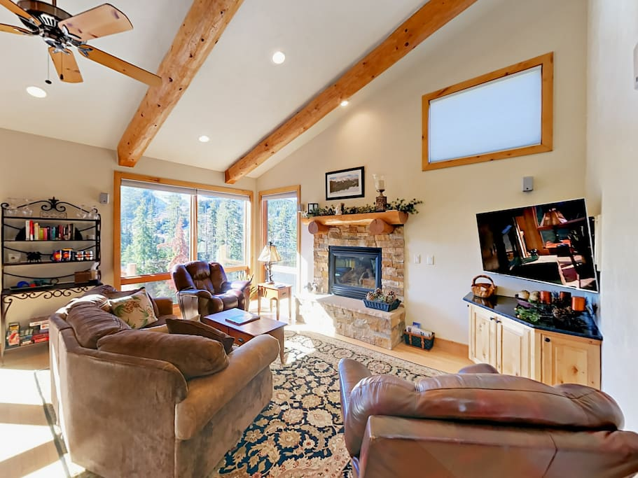 Cozy up in front of the gas fireplace with seating for 6 in the living room.