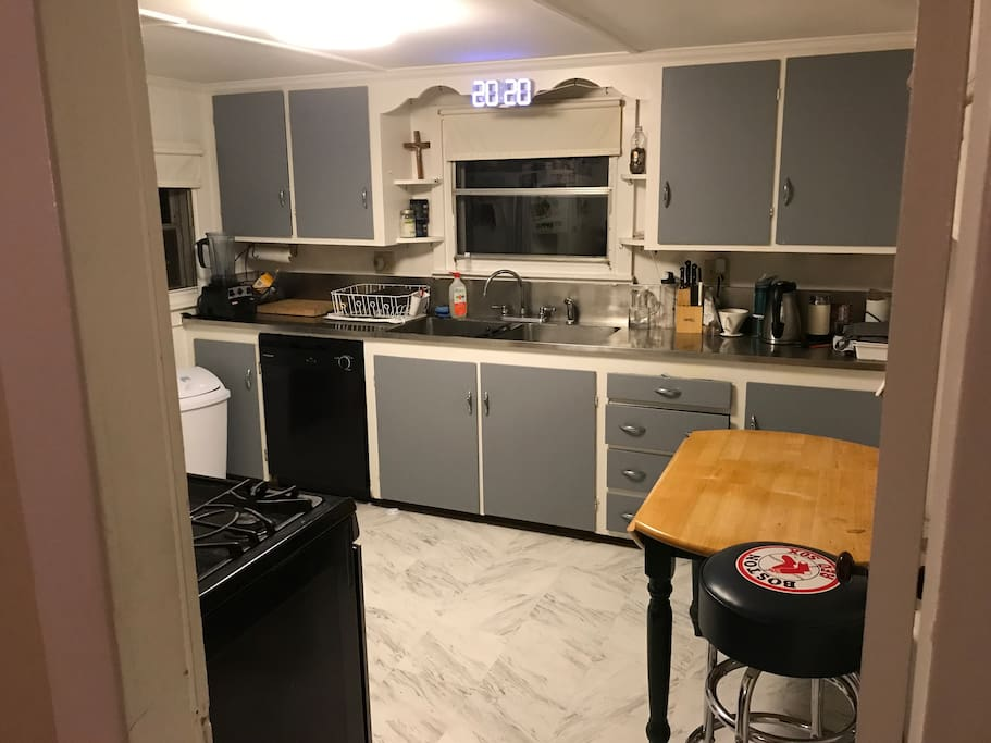 Kitchen has gas stove, brand new dishwasher, garbage disposal and a cool clock.