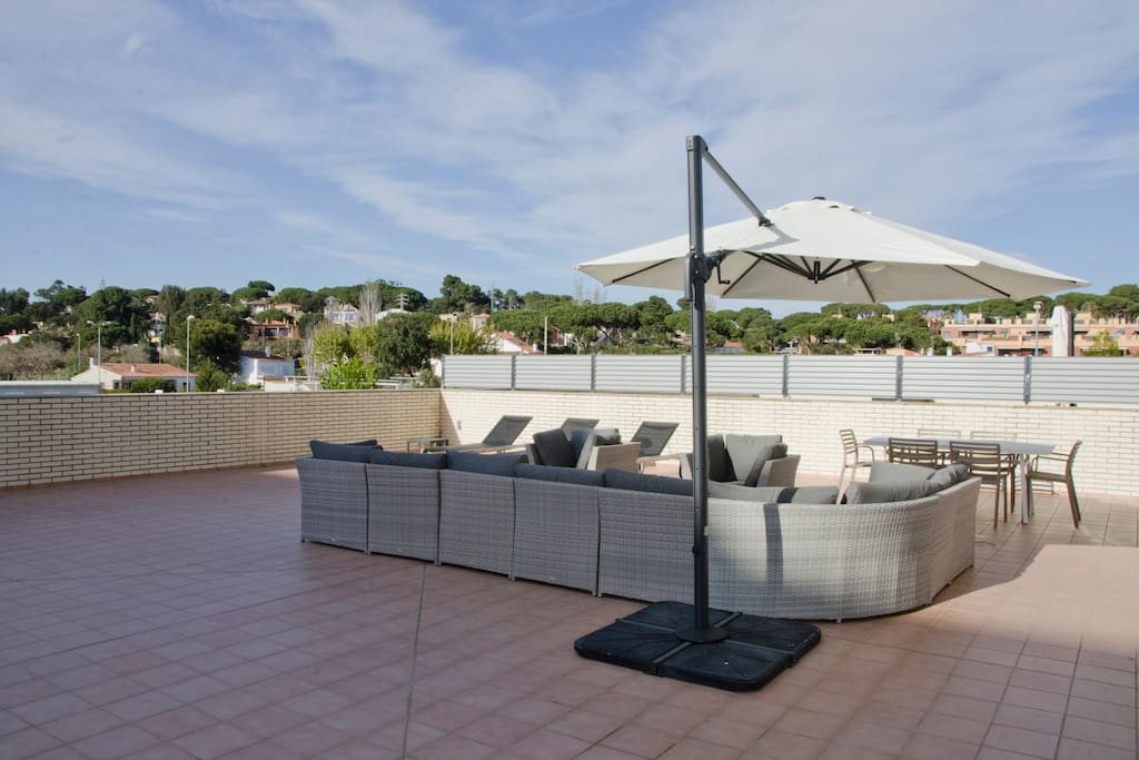 private terrace, apartment, dining table, chairs, loungers, sofas