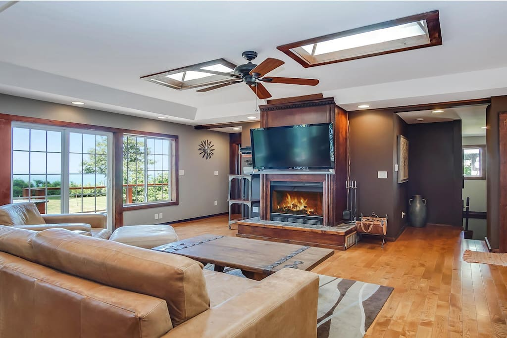 The living area is bright with windows overlooking the lake.