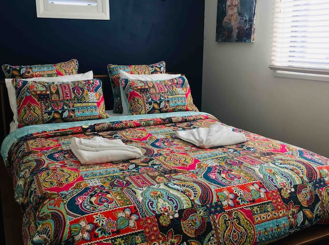 Large queen bedroom that shares space with a single bed and trundle if extra beds are required.