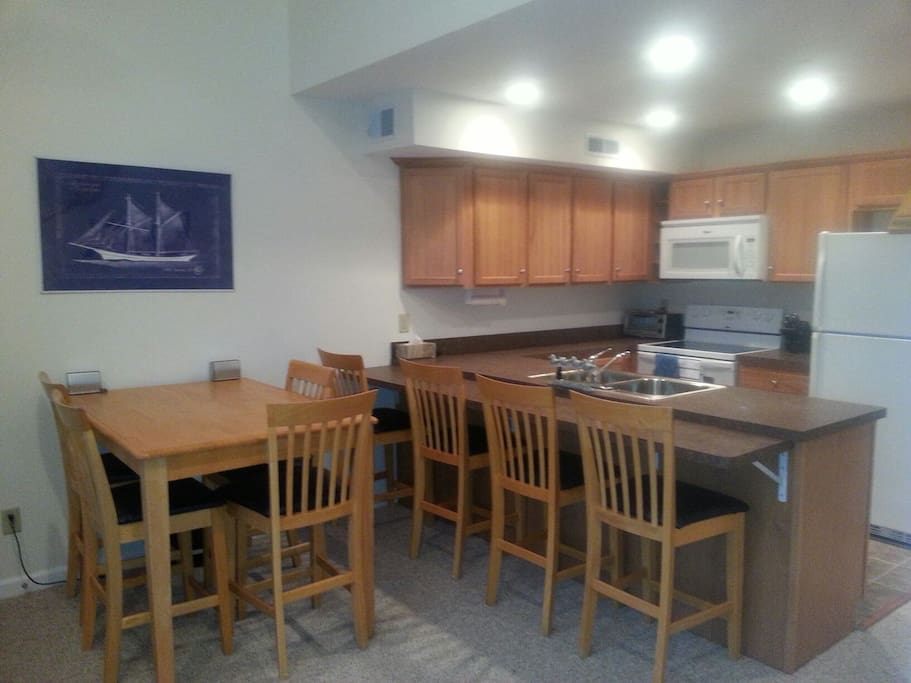 Comfortable open concept seating for eight with both formal & casual dinnerware
